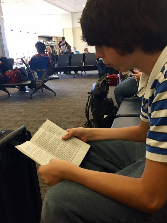"Micah is reading in the airport: ""The Bronze Bow,"" is a children's literature book set in Roman-occupied Israel during the time of Jesus. (http://www.enotes.com/topics/bronze-bow)"